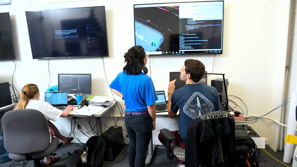 Students look at computer screens in a statistics lab