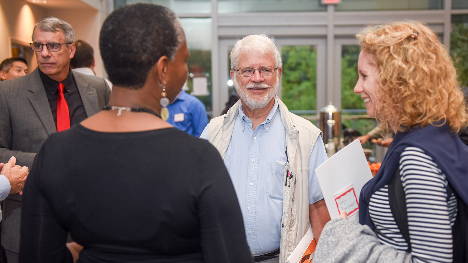 People talk at a reception during the Statistics 75th anniversary celebration