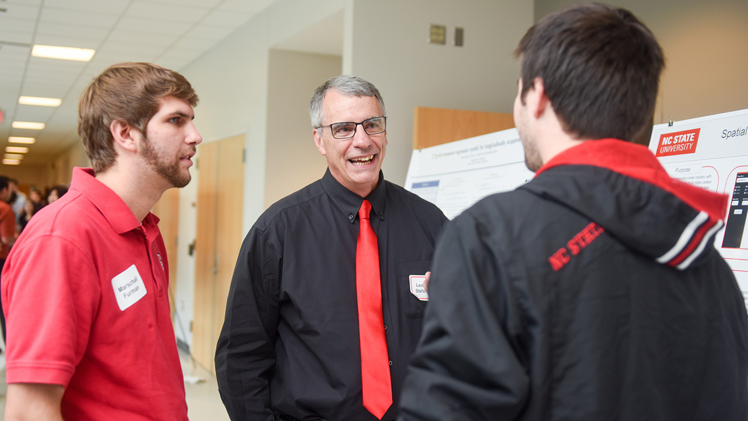 Len Stefanski talks with two students